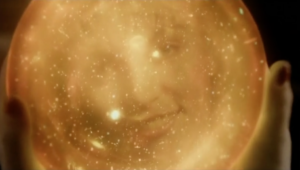golden orb containing visage of Laura Palmer
